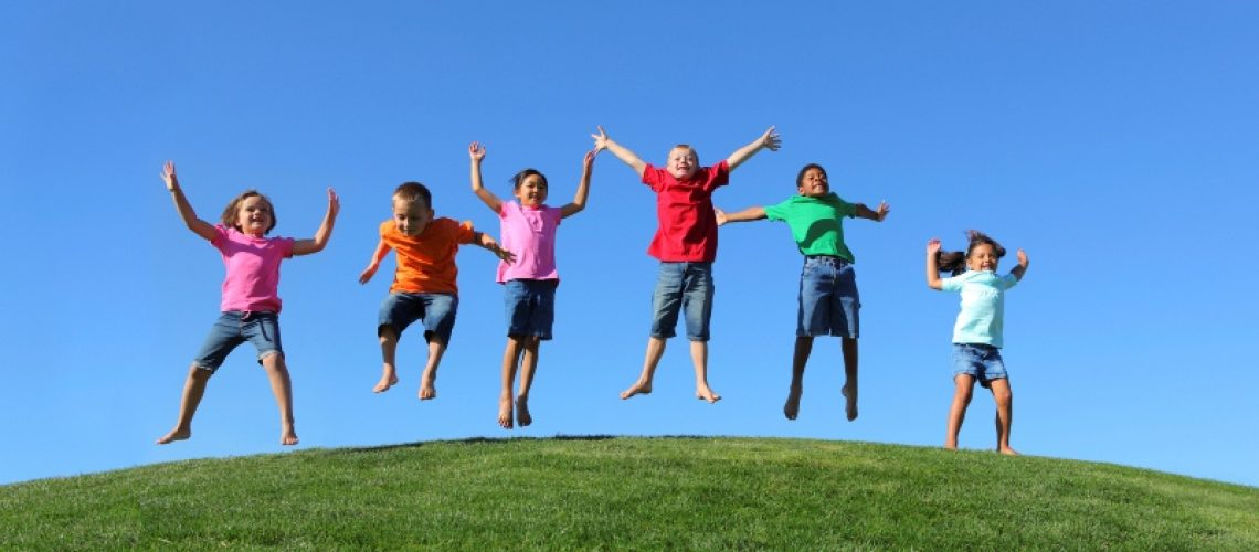Group of multi-ethnic kids jumping together
